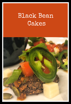 Black Bean Cakes - easy to make and topped with pepitas, cotija, fresh veggies, and chipotle lime vinaigrette