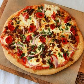 non-traditional pizza brings together the delicious flavors of chorizo and cilantro.