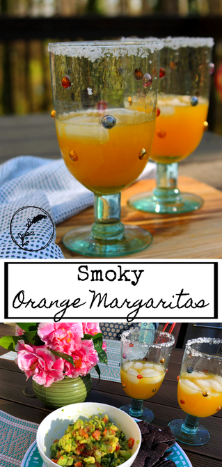 Smoky Orange Margaritas sitting on an outdoor table